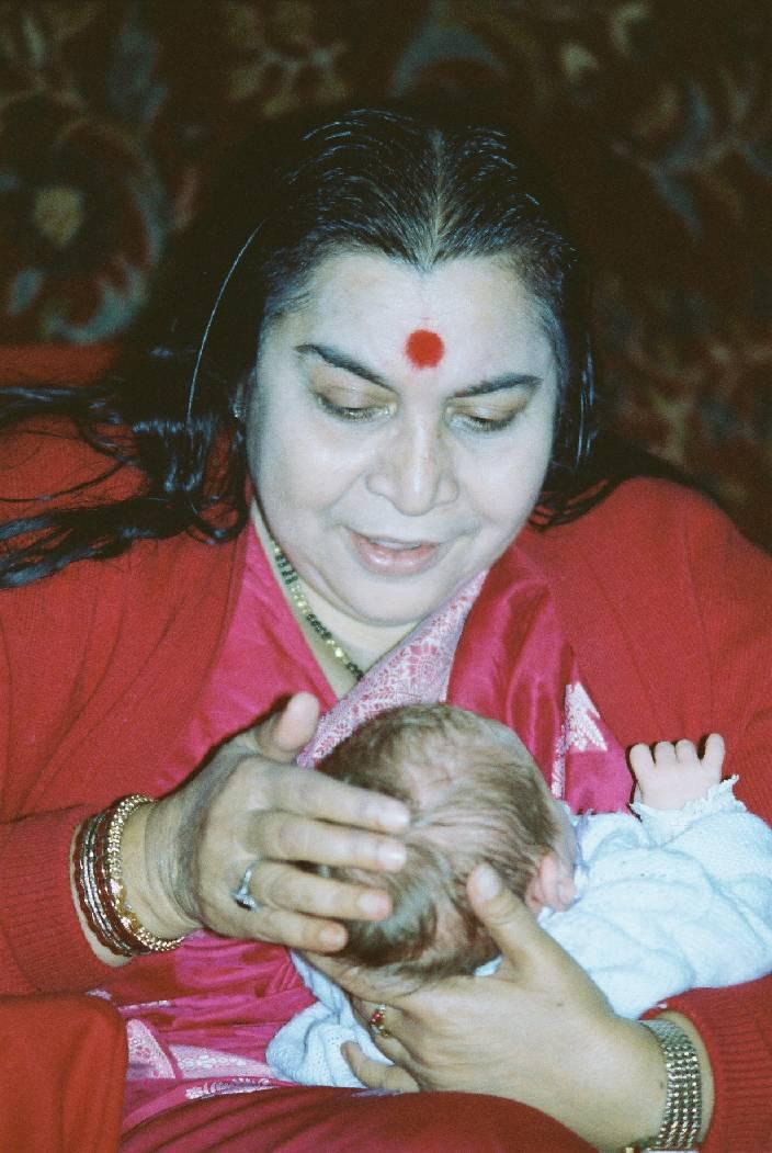 Shri Maaji blessing a newborn baby