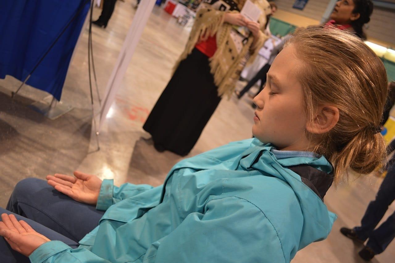 Girl in Meditation @ Sahaja Yoga booth