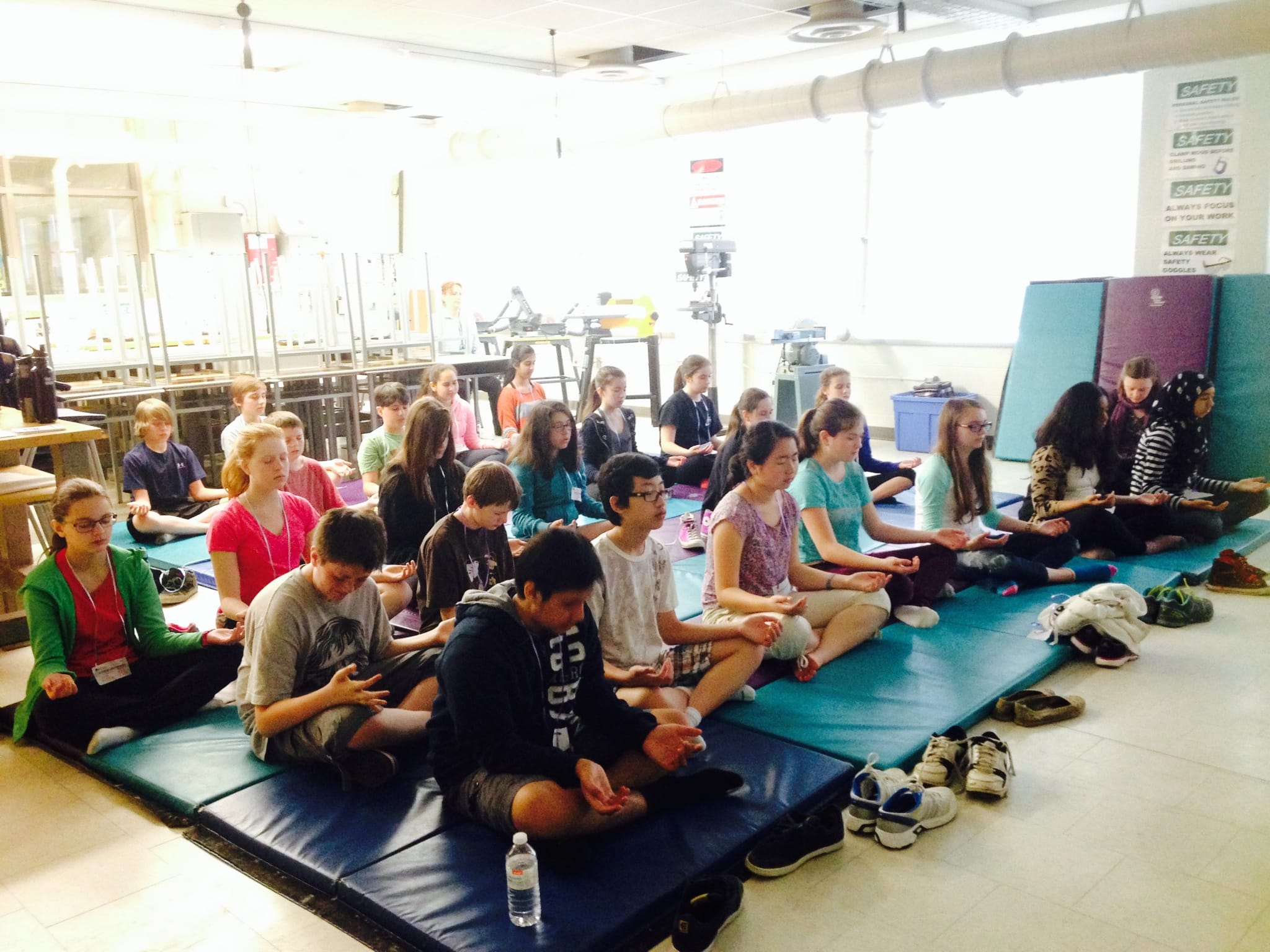 Students meditate during the teens Day workshop