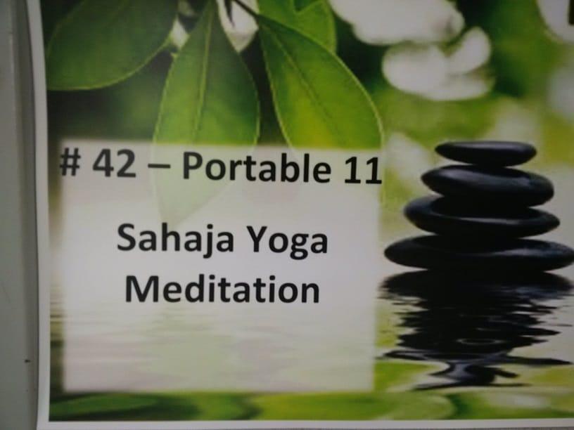 door sign in school for classrooms dedicated to sahaja toga meditaiton workshops