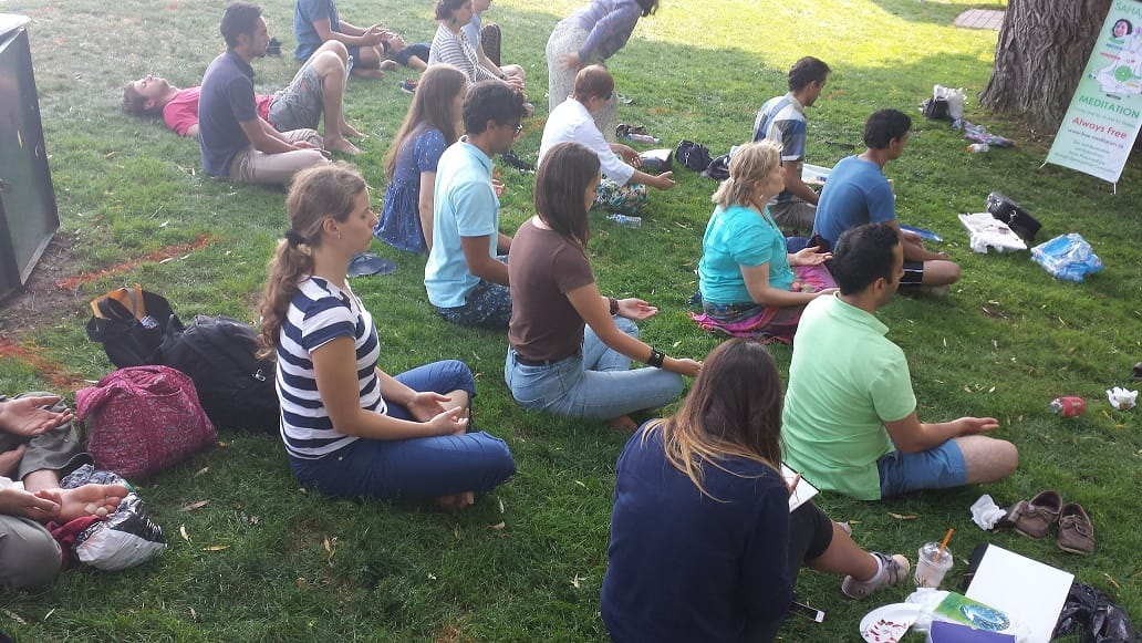 Collective meditation in Specr Smith park in Burlington